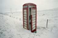 Traditional red telphone box in snow
