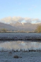 Snow-capped Langdale fells