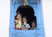 Indian children in an elaborately carved window
